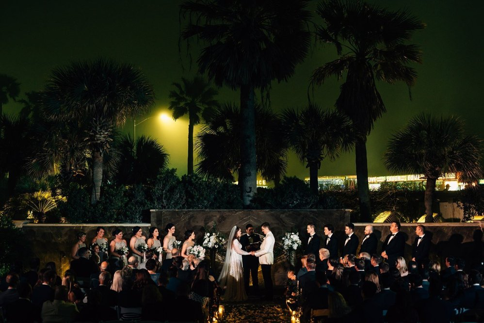 beautiful after dark wedding ceremony galveston