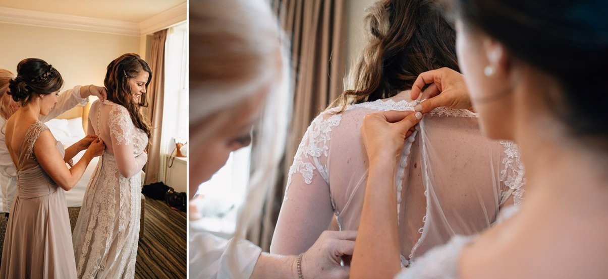 bride's mother and sister help her get dressed