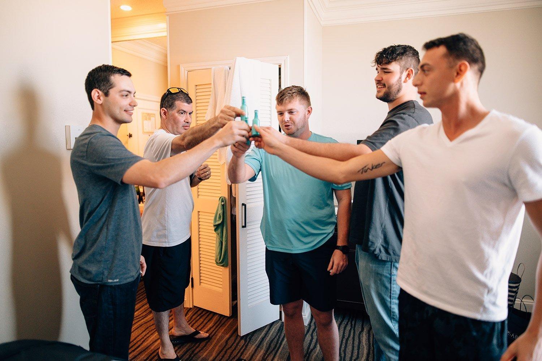 groomsmen taking shots at Hotel Galvez