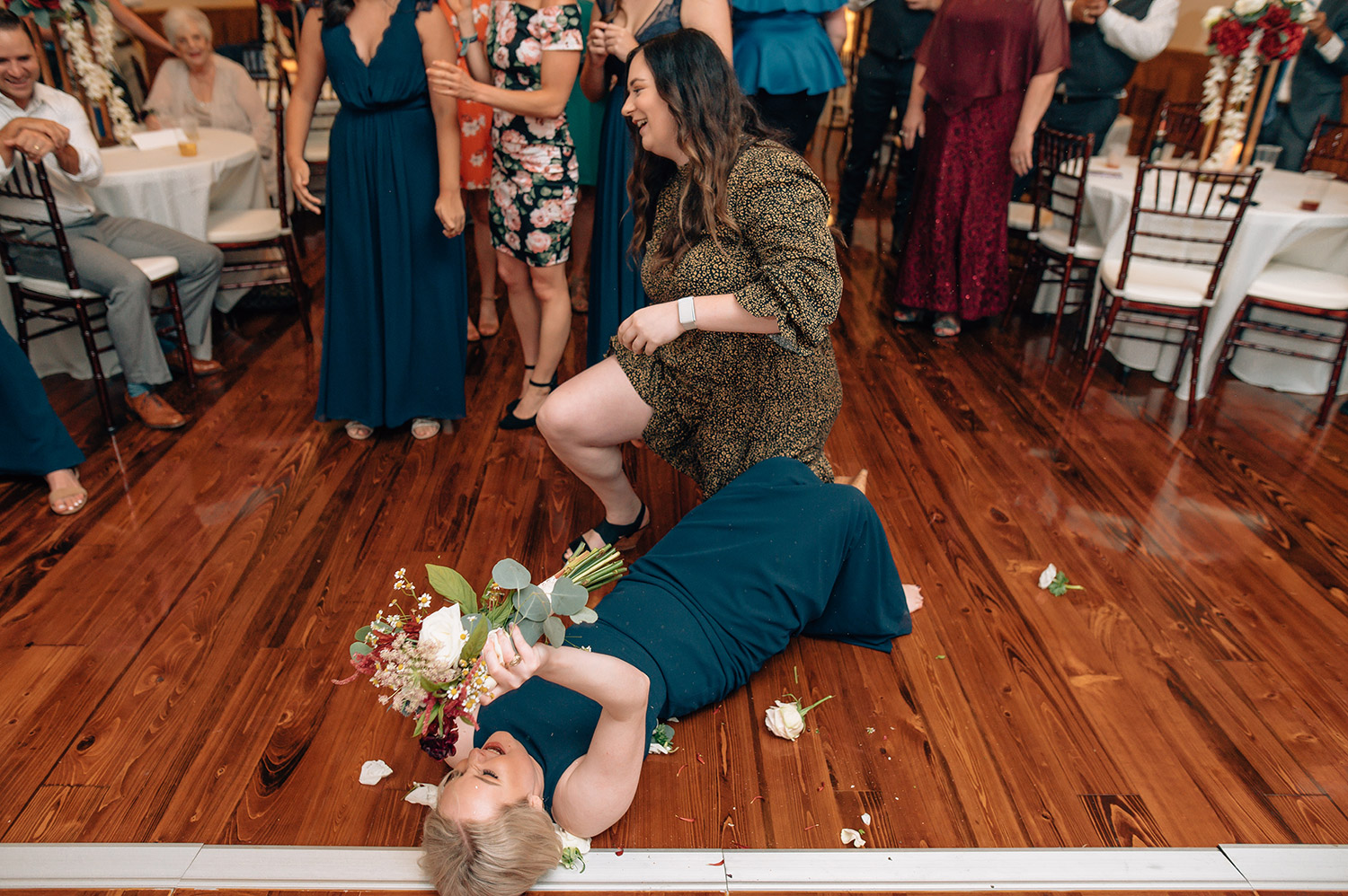 bridesmaid catches bouquet toss