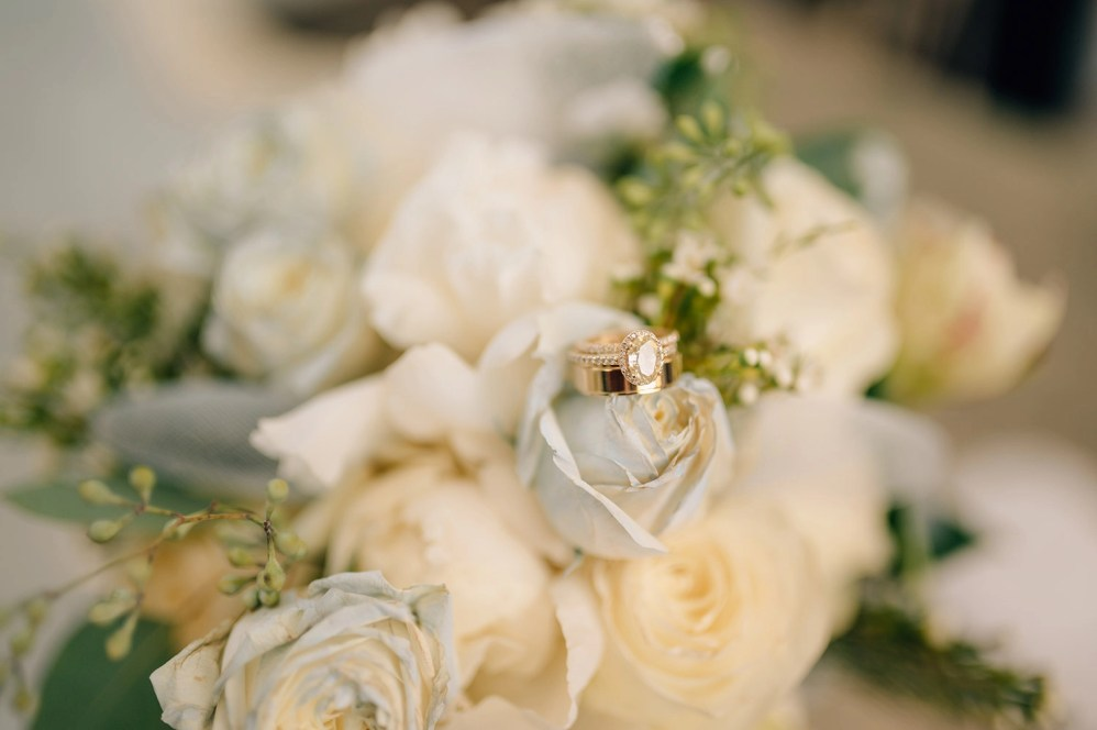engagement ring in bride's bouquet