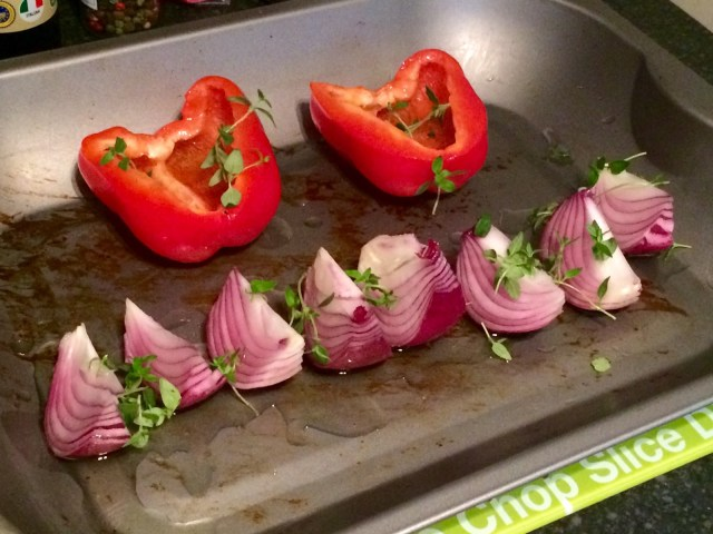 Cover the red onions and red pepper in plenty of olive oil before roasting
