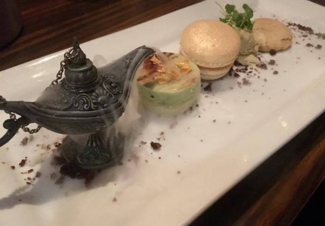 Dessert at Moksh Cardiff - pistachio mousse, curry ice cream, date meringue, sweet hummus macaroon and a magic Genie lamp