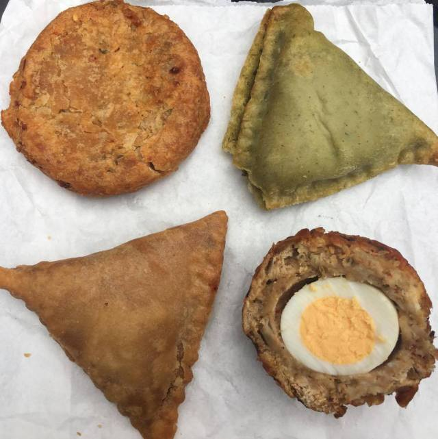 Samosa Co onion bhaji scotch egg, onion bhaji, lamb samosa, and spinach and potato samosa