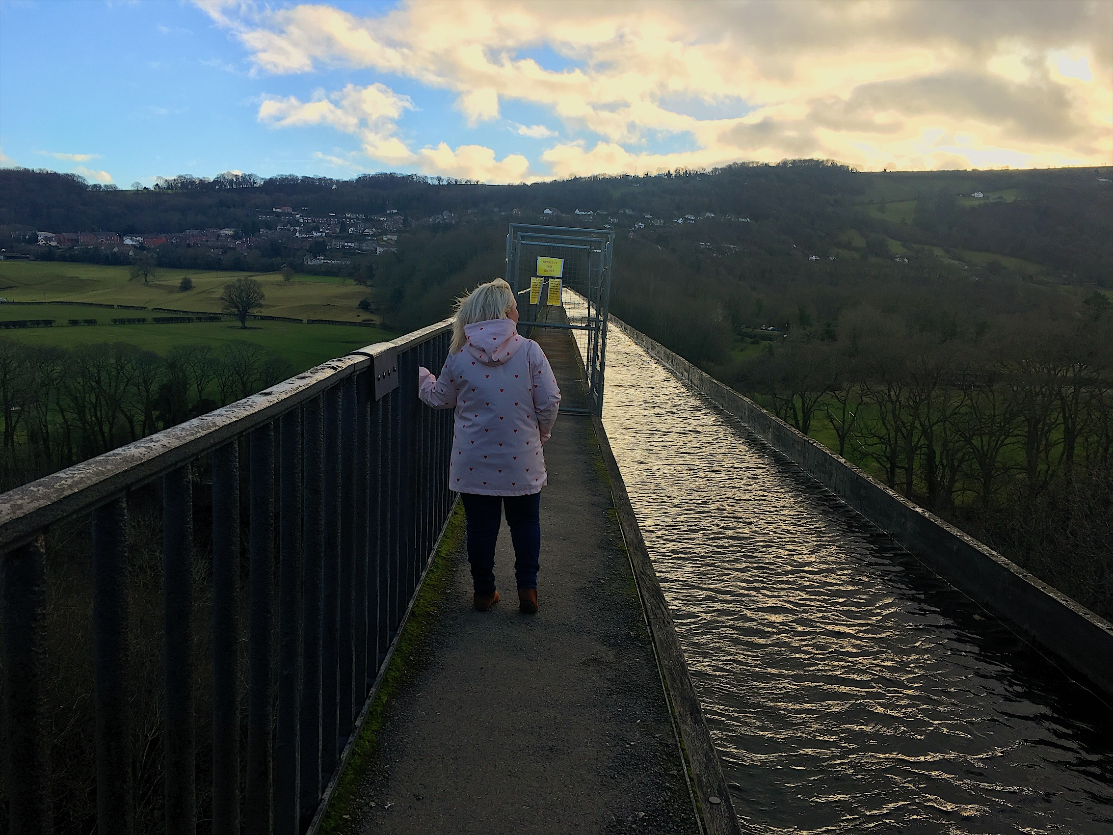 A photo of me at Pontcysyllte Aqueduct, while exploring some of the best things to do in Wrexham.
