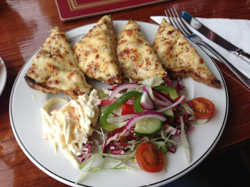 Welsh rarebit with wholegrain mustard, with coleslaw and side salad