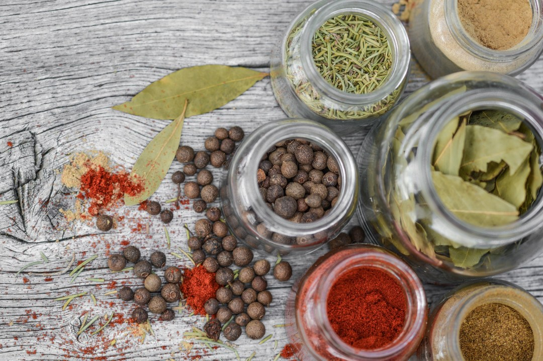 An assortment of herbs and spices - both are store cupboard kitchen essentials