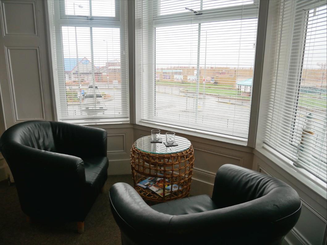 Leather armchairs overlooking Rhyl Beach and the Irish Sea