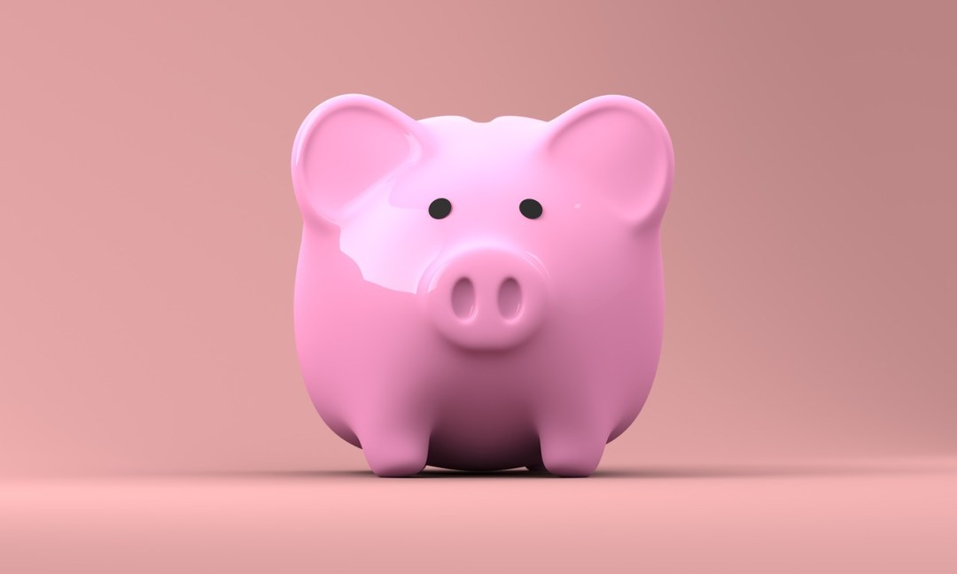 Pink piggy bank - have you ever considered keeping your loose change as a way to save money for travel