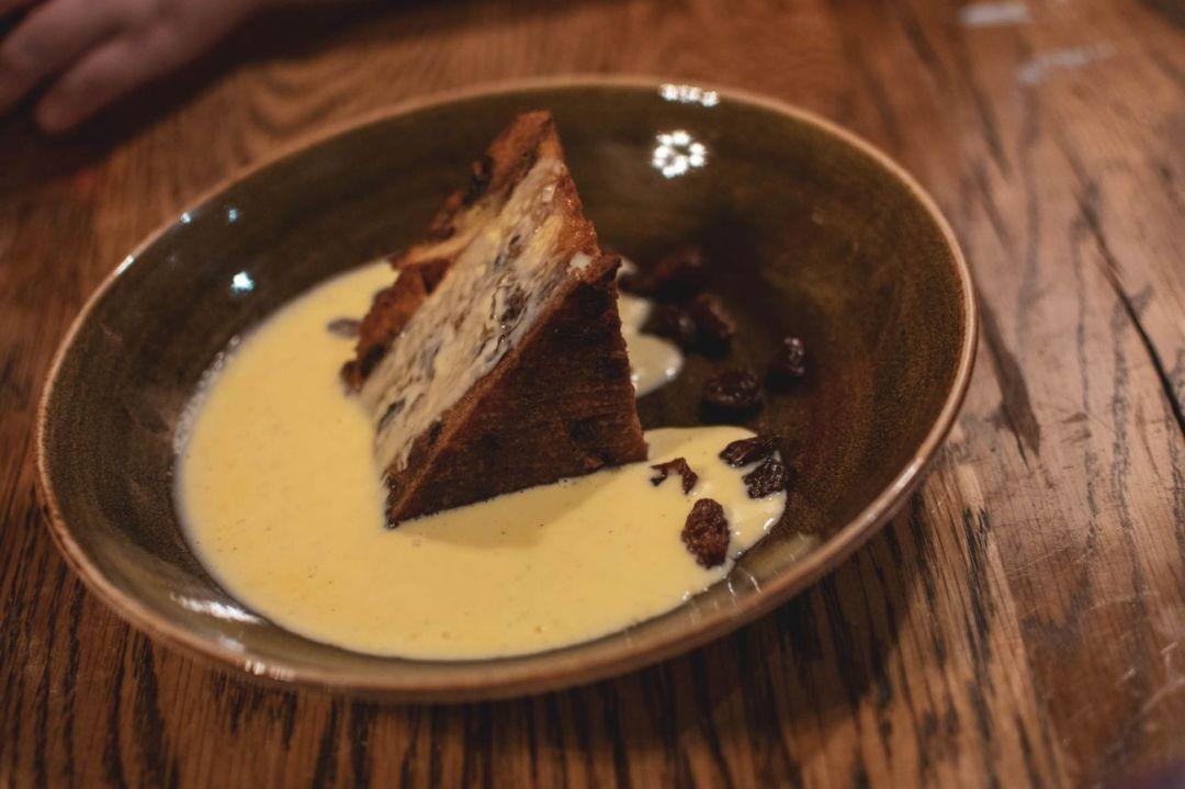 Bara brith brioche bread and butter pudding with vanilla custard at The Exchange Hotel Cardiff
