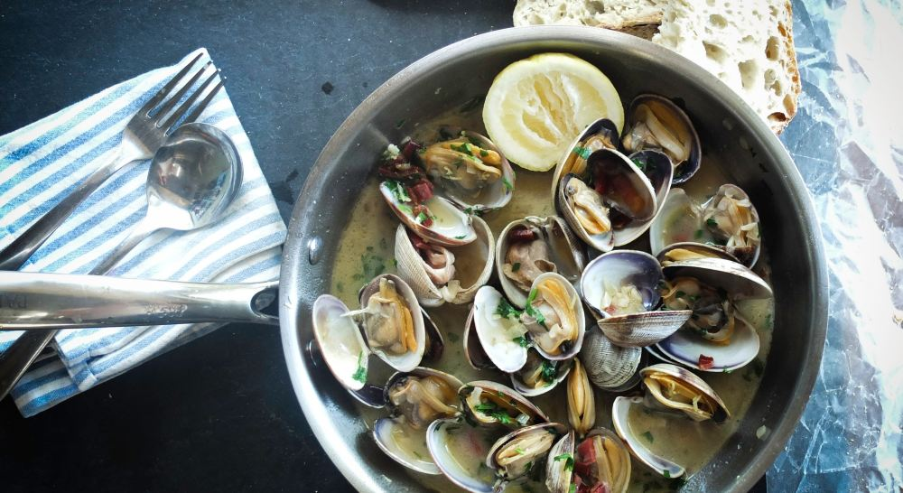 mussels and clams in a bowl. Seafood is one of the favourite dishes on the Algarve. Why not explore all of the top Vale Do Lobo restaurant picks and experience a taste of the Algarve.