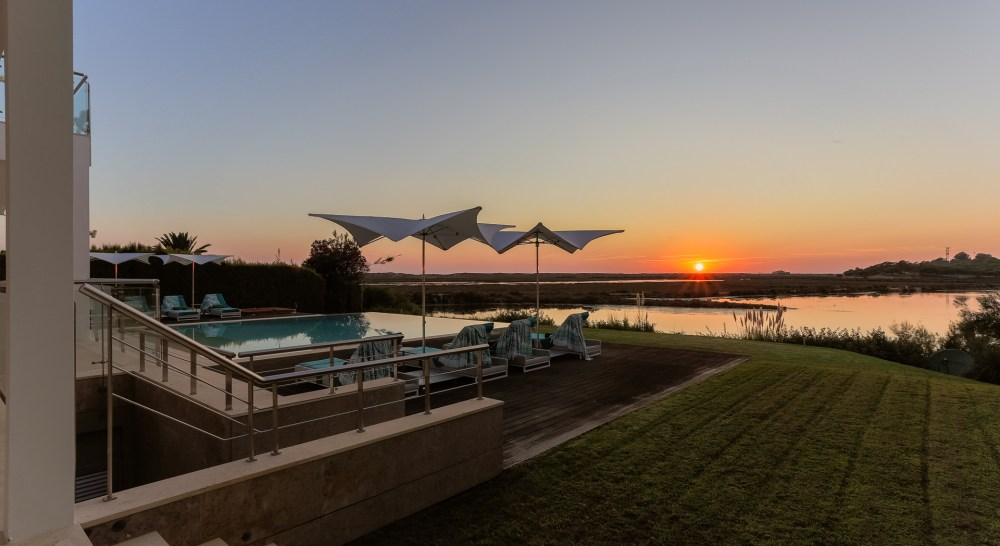 algarve sunset with sun loungers