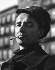 Portrait of folk singer Woody Guthrie smoking cigarette. (Photo by Eric Schaal//Time Life Pictures/Getty Images)