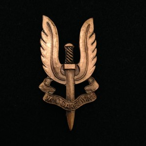 "SAS insignia and motto ""Who Dares Wins"""