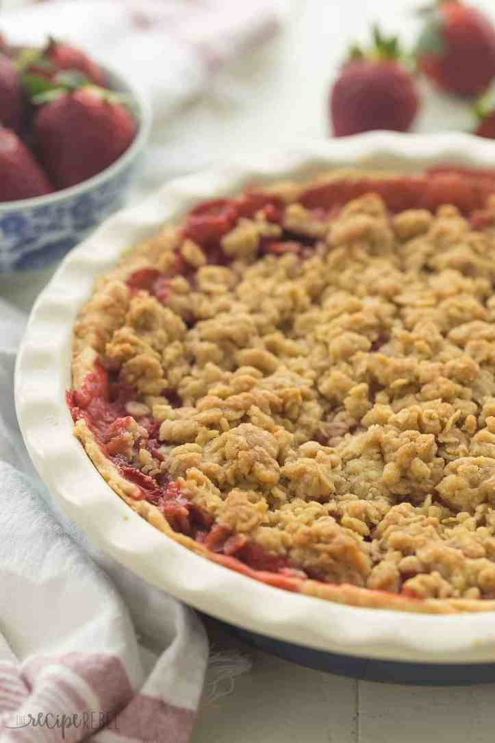 This Streusel-Topped Fresh Strawberry Pie Recipe is loaded with fresh strawberries (though you could use any berries!) and topped with a crunchy brown sugar streusel. The best way to use your summer berries! Perfect for 4th of July or summer cookouts. Includes step by step recipe video. | strawberries | summer | summer recipe | easy recipe | baking | dessert | strawberry dessert