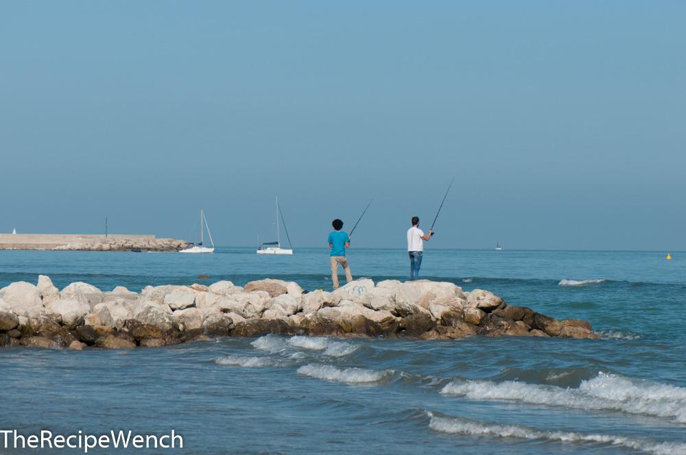 Pescara fishing from jetty
