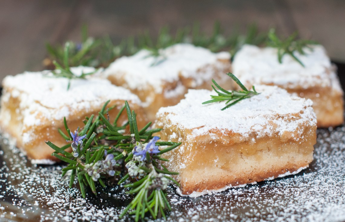 Rich, buttery crust, refreshing lemon and vibrant rosemary. These are SO good! | The Recipe Wench