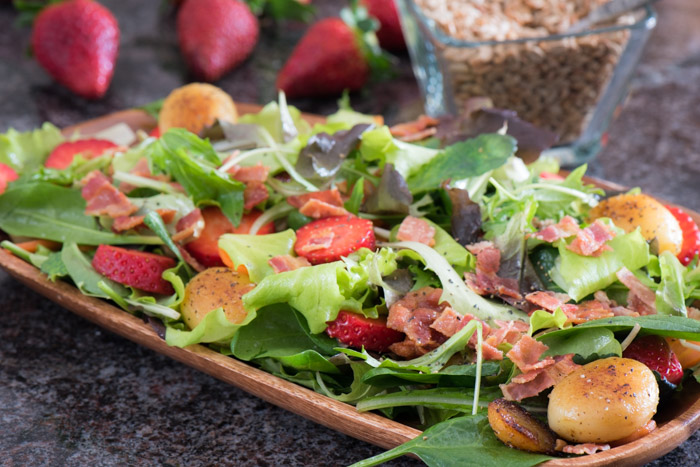 Start your day with a bowl full of crisp greens, sweet fruit, crunchy nuts and a bright tangy dressing. Omit bacon for a vegan option! Mornings never tasted so good!  The Recipe Wench