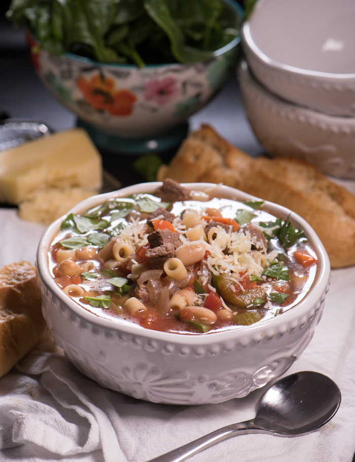 Beef Minestrone is a delicious year-round, versatile soup. Super easy. Feel free to supplement with your favorite seasonal vegetables like zucchini or green beans! | The Recipe Wench