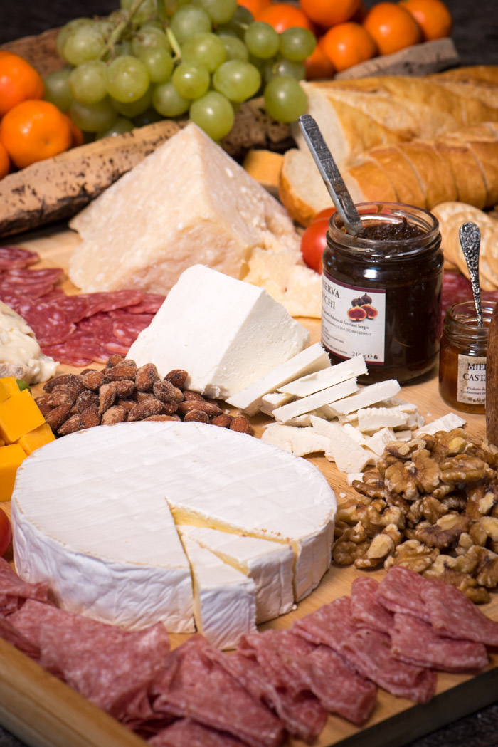 The cheeseboard is an easy eye-appealing appetizer to feed a crowd. Perfect addition to your New Years Eve party! | The Recipe Wench