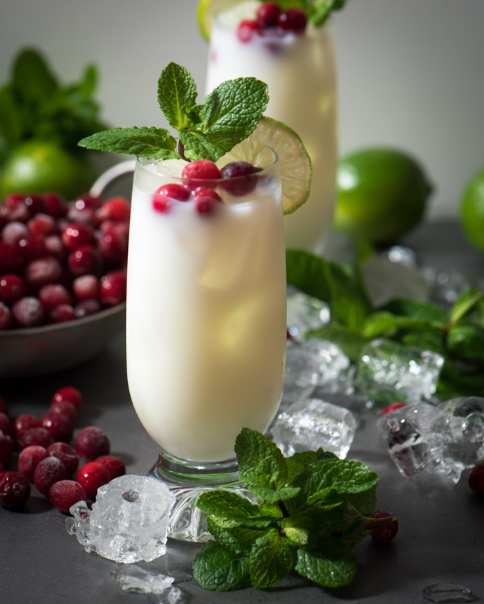 This easy coconut rum holiday cocktail is a little high five from the tropics with a splash of Christmas cheer | www.therecipewench.com