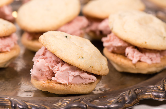 Strawberry ice cream sandwiched between two fresh lemon basil cookies.