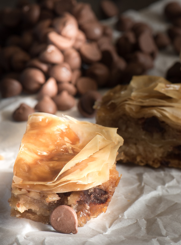 Chocolate Chip Baklava -- delicate, flaky phyllo dough layers over an eggless chocolate chip cookie dough. A great twist on tradition! | The Recipe Wench