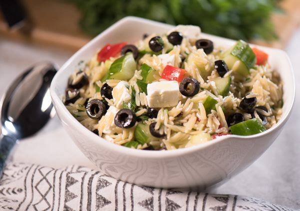 Orzo Salad with tasty feta, black olives and fresh cucumbers and red peppers - drizzle with a little Greek dressing and what a side dish! - Enjoy! | The Recipe Wench