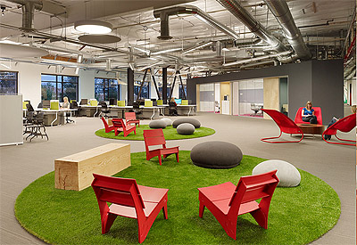 The Skype office in Palo Alto eaturing small patches of lawn with fabric stones and red chairs inside
