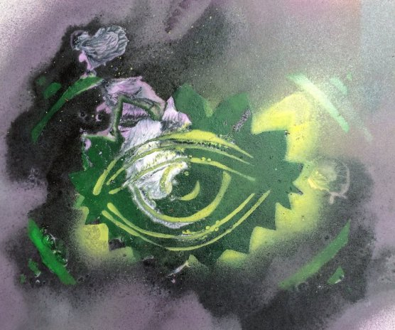 A spray-painted green eye