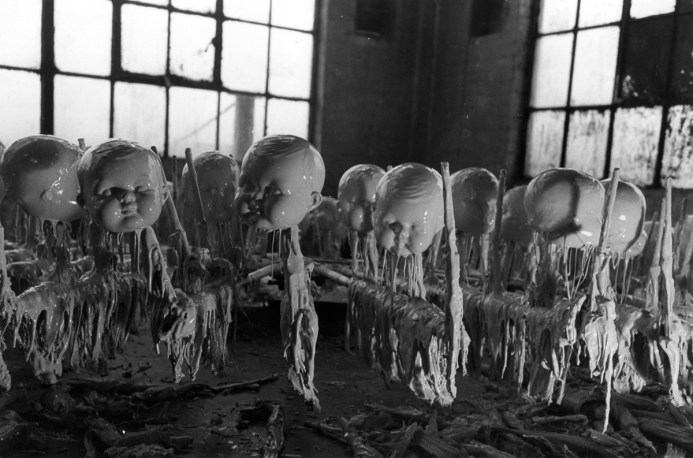 Baby heads in a doll factory, dripping with wet slurry. 1947:  Dolls' heads in the doll factory waiting to dry. Original Publication: Picture Post - 4292 - Dolls Factory - unpub.  (Photo by Merlyn Severn/Picture Post/Getty Images)