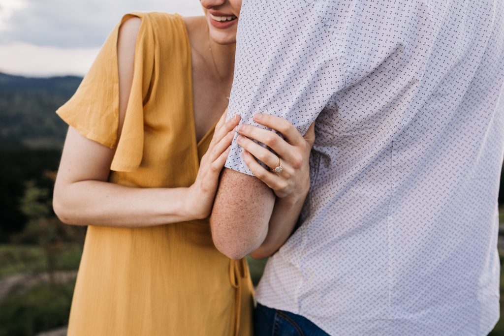 Happy, engaged couple at Black Balsam Knob