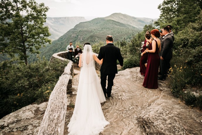 A bride with her father escorting her at Wiseman's View