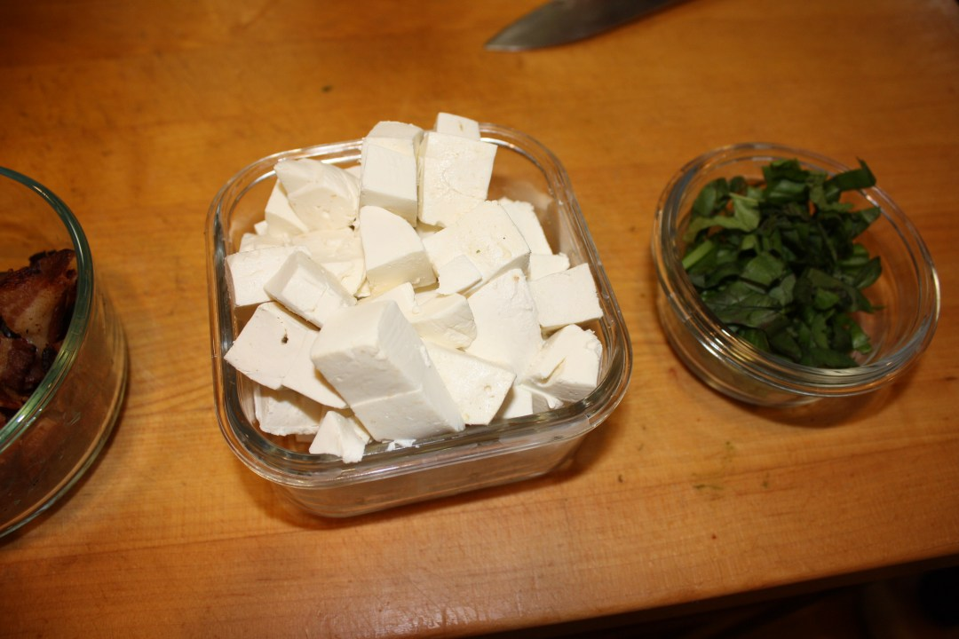 mozzarella and basil chopped in dishes