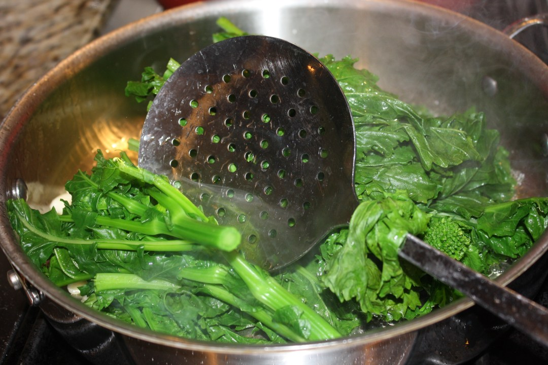 drained broccoli rage into pan