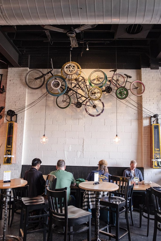 Bicycles hang from the ceiling at Crank Arm Brewing in downtown Raleigh, NC