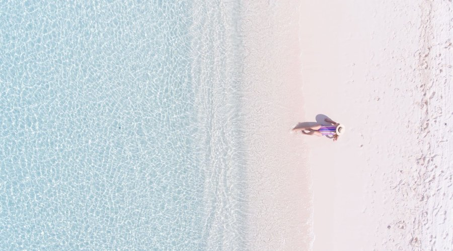 aerial shot of woman on a beach