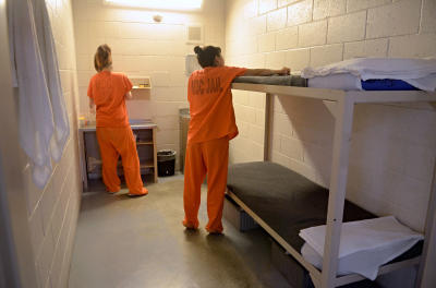 dh091714b/a-sec-metro/09172014---Two female inmates share a cell at the Metropolitan Detention Center, photographed on Wednesday September 17, 2014. (Dean Hanson/Albuquerque Journal)