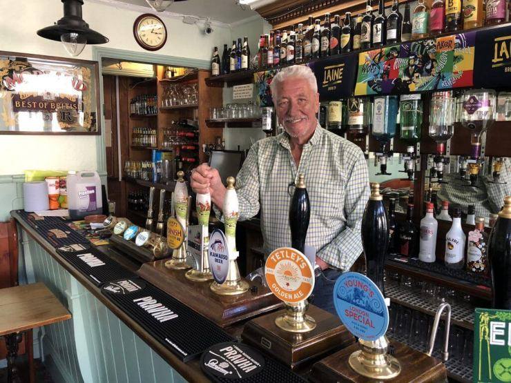 Brain Moignard, landlord of The Retreat pub in Reading, pulling a pint