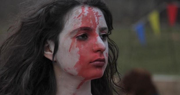 young woman with blood on her face