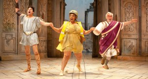 Two men either side of a woman in Roman costume