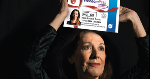 mature woman holding freedom bus pass above her head