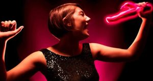 Woman singing into a vibrator