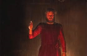 man in red dress which is on fire