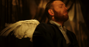 man in jacket with angel wings