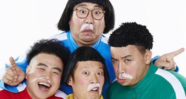 four koren men dressed as toddlers in babygrows
