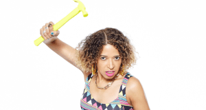 woman holding a yellow hammer
