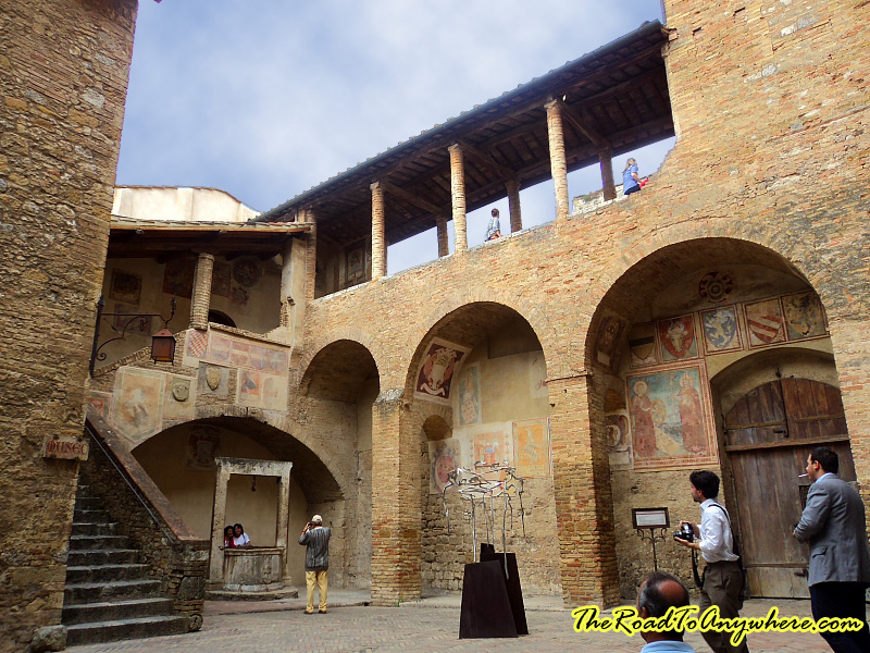 Inside courtyard in the old town hall in San Gimignano, Italy