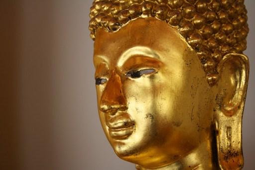 Golden buddha in wat po, bangkok, thailand