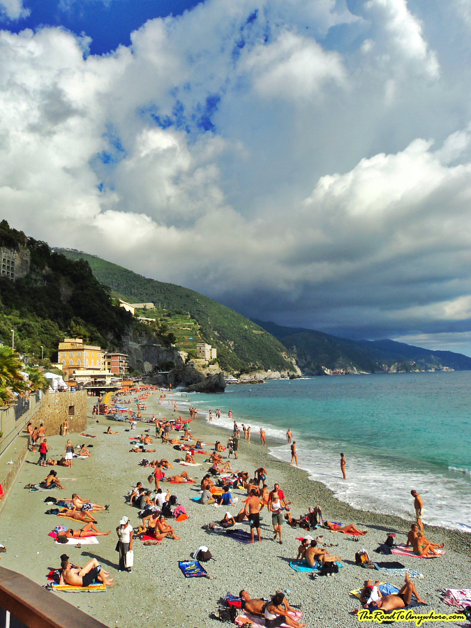 A crowded beach in Monterosso on the Cinque Terre, Italy